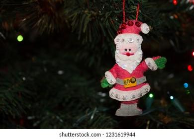 Handmade Fabric Santa Ornament hanging on the Christmas Tree