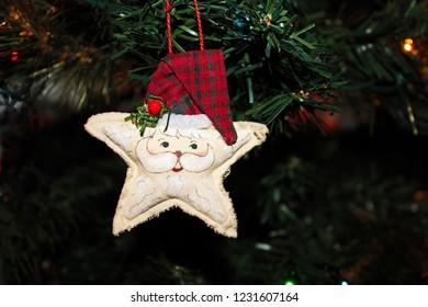 Handmade Fabric Santa Star Ornament hanging on a Christmas Tree
