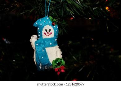 Handmade Fabric Snow Girl Ornament hanging on a Christmas Tree
