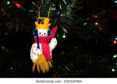 Handmade Fabric Snowman Ornament hanging on a Christmas Tree