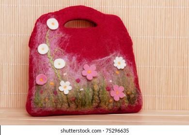 Handmade felt bag with floral decoration.