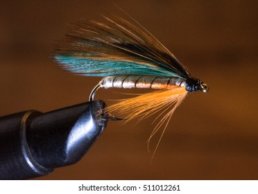 Handmade Fishing Fly in a Clamp