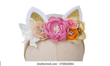 Handmade flower headband with cat ears made out of fabric flowers on mannequin head. This craft flowers design with sweet floral vintage elegance tiara is great for headband girl hairband.