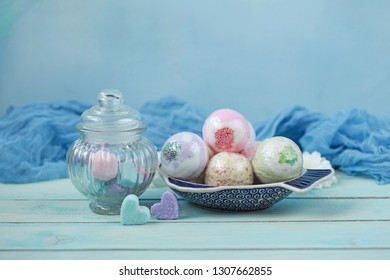 Handmade fragrant multicolored bath balls (bombs) and sugar scrub for hands. Selection focus on some balls.