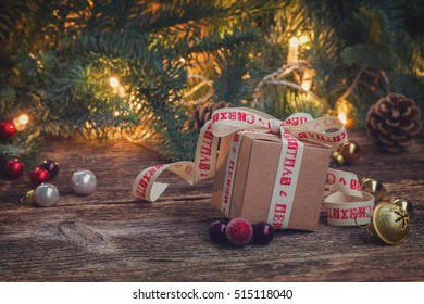handmade gift boxe on wooden background with christmas lights in background retro toned