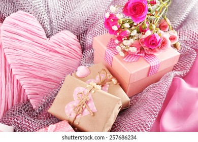 Handmade gifts on Valentine Day, on fabric background