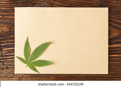 Handmade hemp paper on wooden table, top view. Natural organic handmade paper.