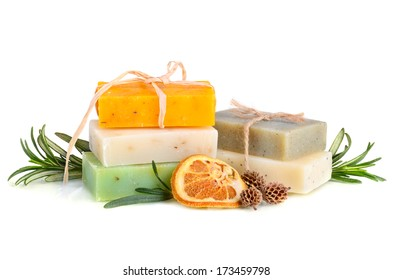 Handmade herbal soaps with rosemary on white background