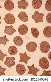 Handmade homemade Christmas gingerbreads on baking paper. Top view background.