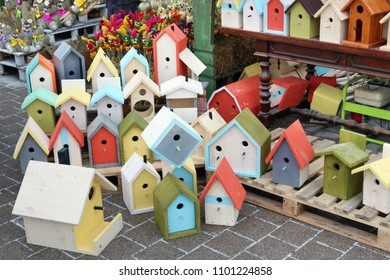 Handmade and  homemade painted birdhouses and feeders are sold on the street during the fair