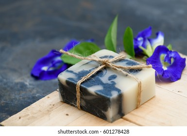 Handmade indigo soap on wooden dark background