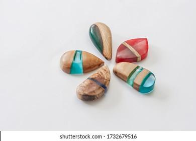 Handmade jewellery made of epoxy resin and wood