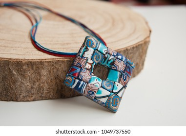Handmade jewelry from polymer clay. Boho ethnic  pendant. Fashion jewelry. Still life. Organic Accessories