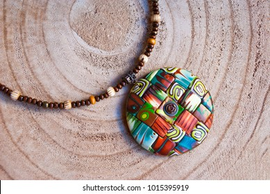 Handmade jewelry from polymer clay. Brown and green mosaic pendant necklace. Fashion jewelry.