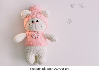 Handmade knitted toy cat on white. Hello kitty. flat lay, top view