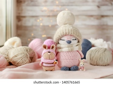 Handmade knitted toys. Amigurumi toys. Crochet stuffed animals. Bunnies and penguin. Miniature crochet dolls