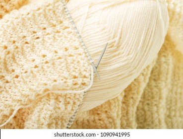 Handmade knitwear, yarn and knitting needles. Background