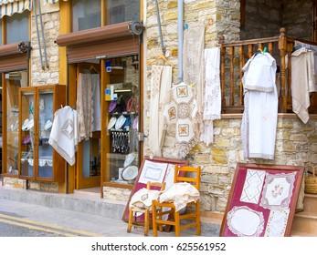 Hand-made laces hang on shop wall. Pano Lefkara, Cyprus.