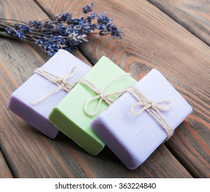 Handmade lavender soap with dry lavender flowers on a old wooden background