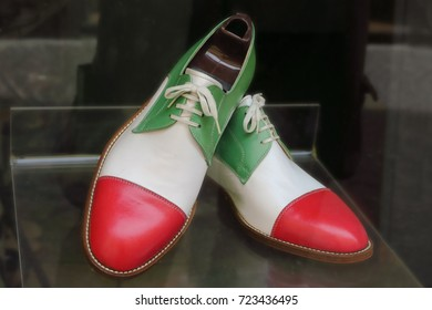 Handmade leather shoes in colors of Italian flag on display in cobbler shop. Mantova, Italy.