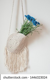 Handmade macrame bag with blue flowers. Summer Concept. Modern design, Scandinavian style, countryside