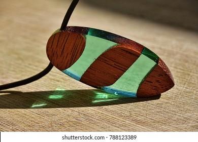 Handmade merbau hardwood pendant with green epoxy resin