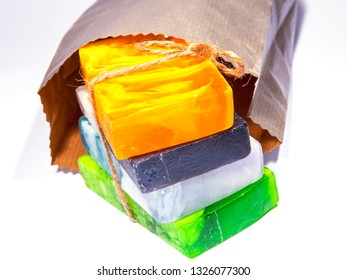 Handmade multi-colored natural cosmetic soap in paper package