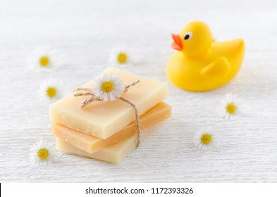 handmade natural baby soap with chamomile flowers and a duck toy