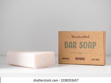 Handmade natural bar soap in recycled paper packaging. Concept of using plastic free shower products to save our planet