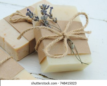Handmade natural bath spa lavender soap on vintage wooden background. Soap making. Soap bars. Spa, skin care. Gift wrapping.