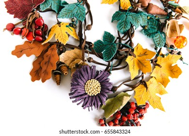 Hand-made necklace with leather imitation of yellow maple leaves, berries, ashberry branches and a big flower.