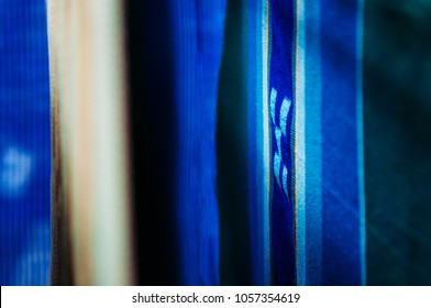 Handmade Okinawa traditional silk or cotton fabric textiles, blue colour with square pattern, close up texture details