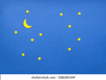Handmade paper cut starry sky, blu sky with yellow stars.