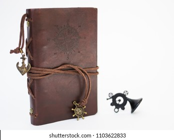 Handmade paper diary notebook in brown leather cover with over white background