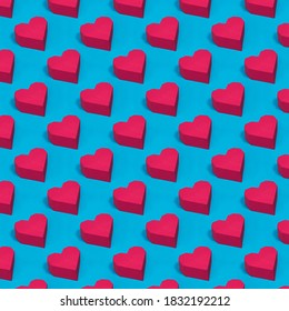 Handmade Paper Red Hearts Pattern With Shadows. Pattern of handmade from red paper, craft hearts figures diagonally arranged on a background with hard shadows. Valentine's card.