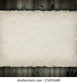 Handmade paper sheet on wooden planks background