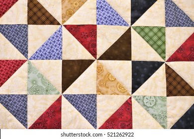 Handmade Patchwork quilt as background. Flower print. Color blanket in style patchwork.