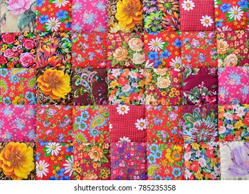 Handmade patchwork quilt with floral pattern as background.  Retro style handmade blanket on market in Suzdal, Russia