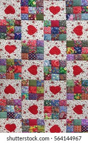 Handmade Patchwork Quilt Floral Summer Pattern Background With Hearts. Vintage Scrappy Geometric Quilting Texture. Patch Work Colorful Folk Style Design Surface. Sewing Handwork Product Wallpaper.