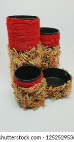 handmade pens support with red thread and fluffy pieces of textile glued on it