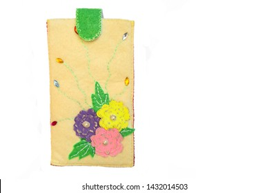 Handmade phone case made of felt with colorful fabric flowers