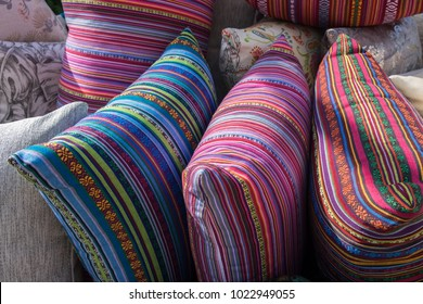 Handmade pillows with colorful covers. For sale at farmers market