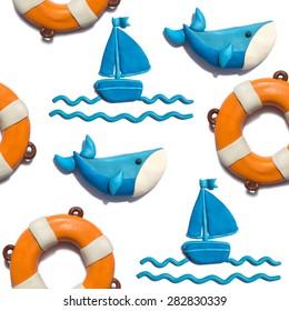 Handmade plasticine seamless pattern with summer objects. Whale, ship and safe ring background.