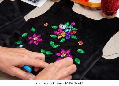 Handmade Polish traditional costume (Stroj Krakowski) in the making. - Shutterstock ID 1485437747