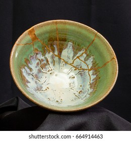 A handmade pottery dish I broke and repaired using the Japanese art form of kintsugi.