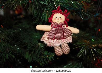 Handmade Raggedy Ann Doll Ornament hanging on the Christmas Tree