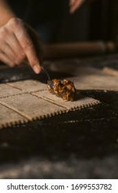 Handmade ravioli pasta  - Darkfood photography - italien Girl making pasta