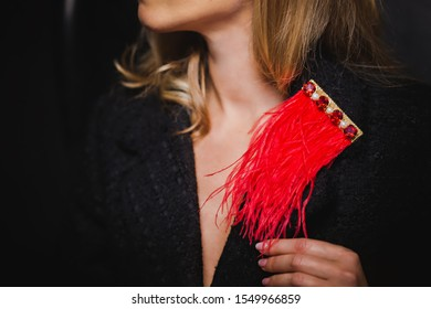 Handmade red brooch made of ostrich feathers and rhinestones