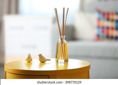 Handmade reed freshener in living room, close up
