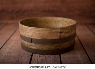 Handmade round brown wooden bowl for newborn posing, empty newborn prop